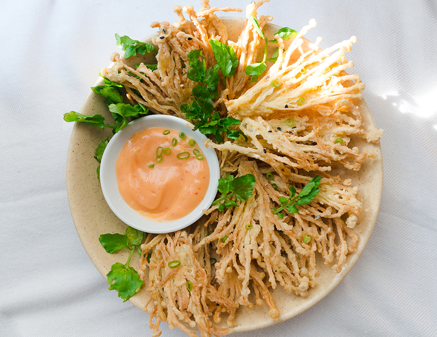 Crispy Enoki Mushrooms in a plate with kimchi mayonnaise on the side